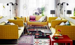 Living room with five IKEA sofas in a U-shape. Rugs, mirrors, lamps and table.