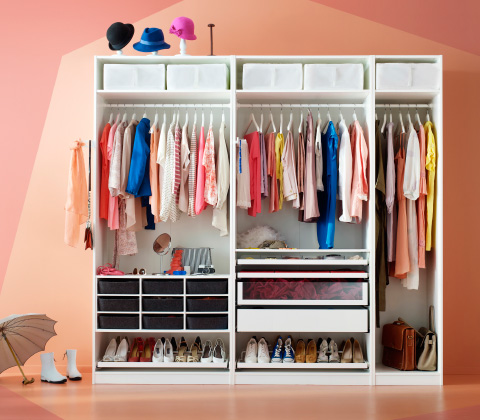 A white PAX wardrobe combination without doors, showing multicolored clothes, shoes and hats plus small storage boxes.