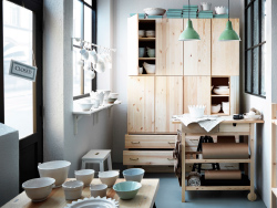 A porcelain boutique with wall cabinets, chest of drawers and trolley in solid wood