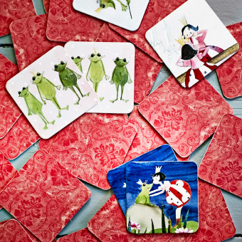 red cards scattered on a table, some showing pictures of fairytale themes.