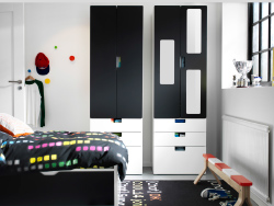Kids' room with STUVA storage in black and white, FLAXA bed in b/w and IKEA PS 2014 bench