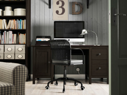 A brown home office with HEMNES table and bookcase in brown and a black GREGOR chair