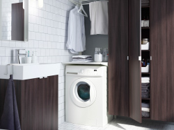 A modern bathroom with integrated laundry, including ALGOT drying rack plus LILLÅNGEN cabinet and washbasin in black brown