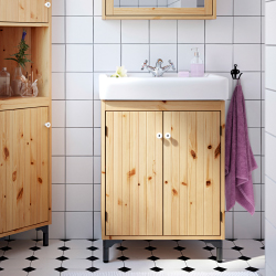 Pine furniture in a bathroom with white tiles.