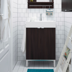 Close-up of a dark brown wash-stand in a bathroom with white tiles.