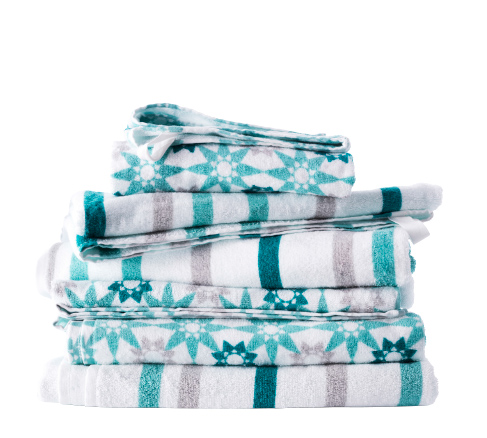 A stack of differently styled  towels in white and turquoise