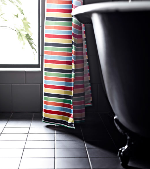 A multicolored shower curtain.