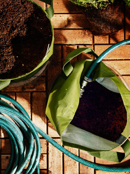 A green bag with soil, seen from above
