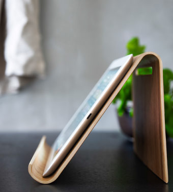 A close-up of a bamboo tablet stand.