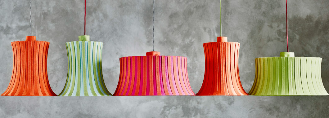 Display of lamp shades in different colours and sizes.