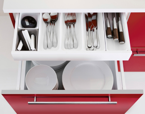 A kitchen cabinet with one visible drawer and one extra inner drawer, seen from above.