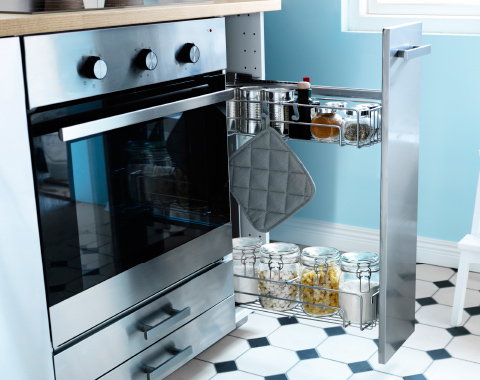 A narrow kitchen cabinet with pull-out interior fittings in steel.