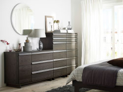 A bedroom with two, chest of 6 drawers and one, chest of 3 drawers with 1 door, all in brown stained ash veneer.
