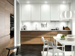 A contemporary kitchen with black brown cabinets, high gloss white cabinet doors and dark worktopsA kitchen with walnut effect doors, white accent doors and white worktop. Combined with stainless steel extractor hood, dark grey oven and microwave oven.