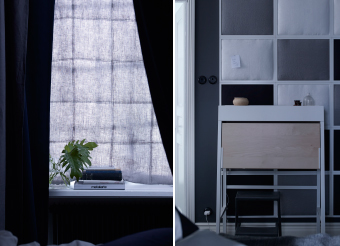 Two ways of bedroom soundproofing. One: a soundproofed curtain hung infront of the window and two: a soundproofed wall made from fabric-filled photo frames. Plus, a muted colour tone of dark blues and greys helps the bedroom feel calm.