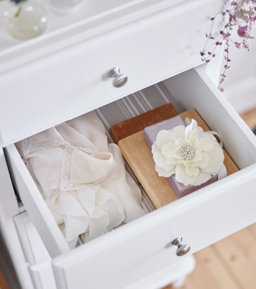 A close-up of an opened drawer