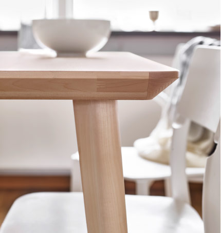 Close-up of a dining table in ash veneer.