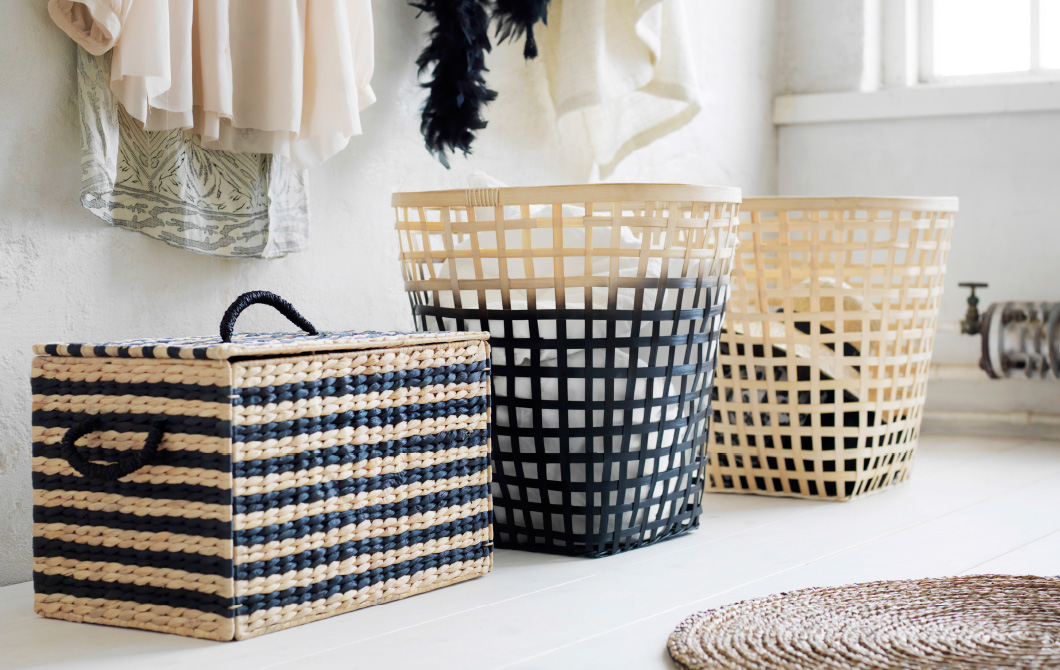 A display of a storage box made of water hyacinth and baskets made of bamboo.