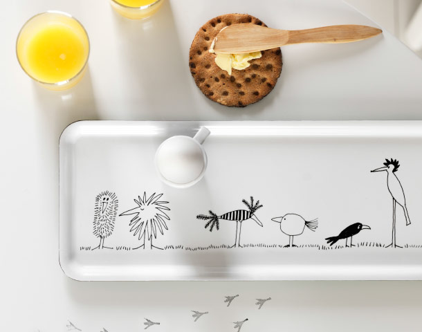 A tray with a pattern of funny birds in black and white.