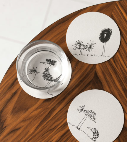 Coasters with different patterns of funny birds in black and white.