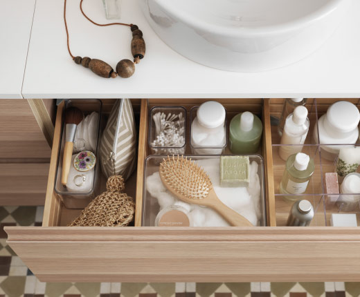 Close-up of a drawer with bathroom accessories