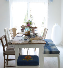 Create a natural and relaxed dining room table with mix of handmade textiles.