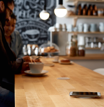 A bar counter with wireless charging.