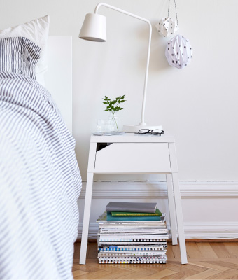 A Bedside Table With Wireless Charging