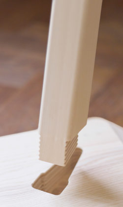 Close-up of a table leg in ash veneer.