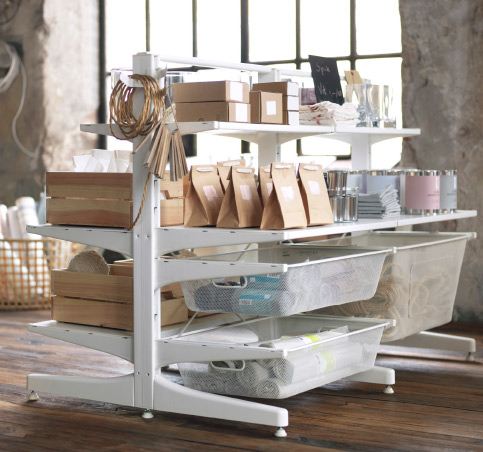 A white free-standing shelf solution with mesh baskets.