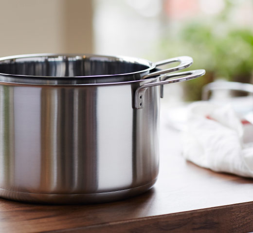 A small stainless steel pot stacked inside a larger pot.