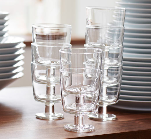 Several wine glasses in tempered glass stacked inside each other.