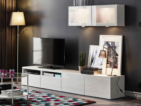 BESTÅ TV storage combination with shelving units and glass doors.