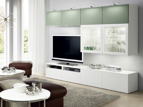 BESTÅ TV storage and display combination with shelving units with glass doors.