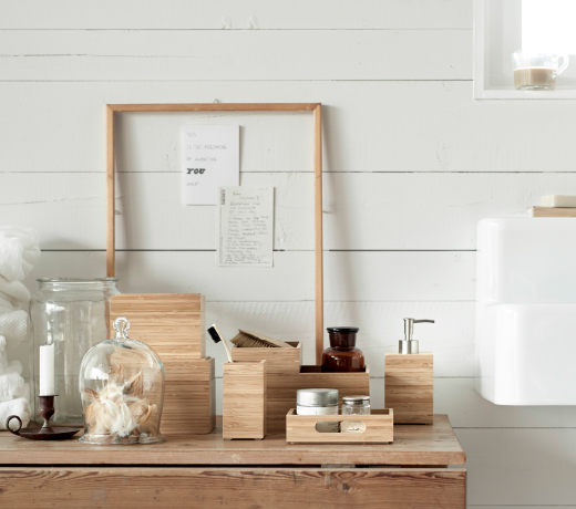 A display of boxes, soap dispenser and toothbrush holder, all in bamboo.