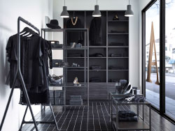 A clothes boutique with black and grey displays