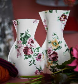 Feeling crafty? Put those DIY skills and creativity to work! Floral patterns are a big deal right now, so double up with this homemade vase cover.""