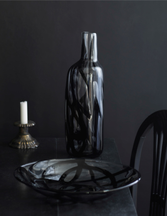 Handmade vase and bowl in clear glass with black pattern.