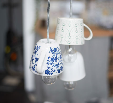 Three porcelain cups used as lamps