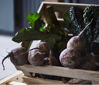 A close-up of a storage crate filled with beetroots.