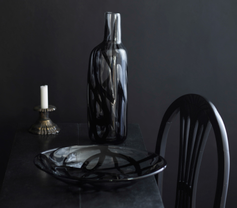 Handmade vase and bowl in clear glass with a black pattern.