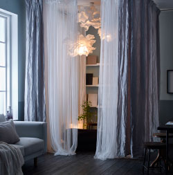 Create a cocoon in the corner of your living room using textiles, soft lighting and calming accessories