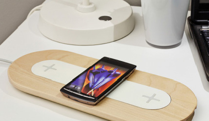 Close-up of a wireless charger and a smartphone.