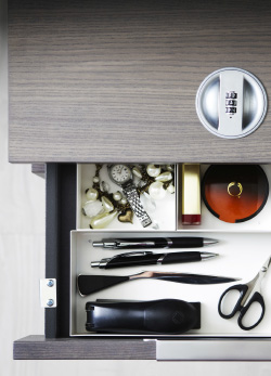 A grey drawer unit with a combination lock, seen from above.