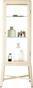 A glass-door cabinet with glass bottles and shaving brushes inside.