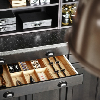 Close-up of an open drawer with a bamboo cutlery tray inside.