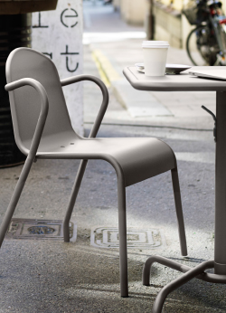 A close-up of a grey armchair and a foldable table.