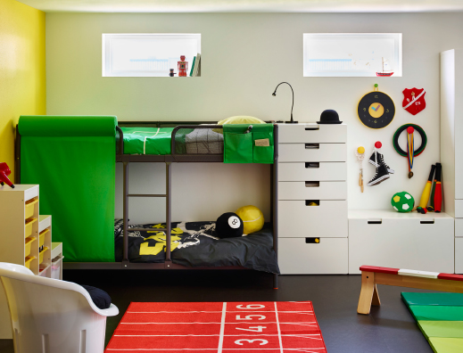 A children's room with a gray bunk bed and white storage combined with colorful bedlinen and rug.
