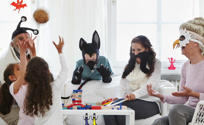 A family dressed up in different costumes and playing games.