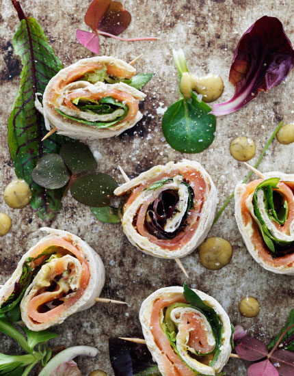 Mini wrap rolls with salmon and mustard sauce.
